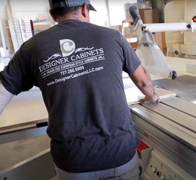 designer-cabinets-worker-loading-wood-panels